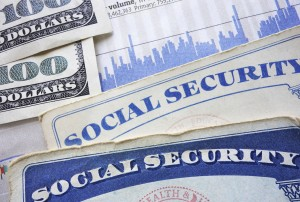 Social Security cards, cash and stock market chart